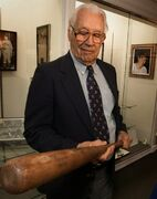 FILE - In this 2001 file photo Bob Feller holds the bat Babe Ruth leaned on during his farewell speech in Van Meter, Iowa, at The Bob Feller Museum. The museum honoring the late Hall of Fame baseball pitcher Bob Feller will be transformed into Van Meter's new city hall. (AP Photo/The Des Moines Register, Bill Neibergall, File) MAGS OUT, TV OUT, NO SALES, MANDATORY CREDIT