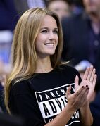 Kim Sears, fiancee of Andy Murray of Britain, applauds before his men's singles final against Novak Djokovic of Serbia during the men's singles final at the Australian Open tennis championship in Melbourne, Australia, Sunday, Feb. 1, 2015. (AP Photo/Rob Griffith)