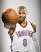 Oklahoma City Thunder's Russell Westbrook poses for photos during NBA basketball media day at Chesapeake Energy Arena, Monday, Sept. 29, 2014 in Oklahoma City. (AP Photo/Brett Deering)