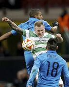 Celtic's John Guidetti, center, jumps for the ball with Inter Milan's Juan Jesus, top, and Inter Milan's Gary Medel during a Uefa Europa League, round of 32 second leg soccer match between Inter Milan and Celtic at the San Siro stadium in Milan, Italy, Thursday, Feb. 26, 2015. (AP Photo/Luca Bruno)