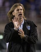 FILE - In this March 31, 2010 file photo, Argentina's Velez Sarsfield's soccer coach Ricardo Gareca gestures during a Copa Libertadores soccer game with Brazil's Cruzeiro in Belo Horizonte, Brazil. Brazilian club Palmeiras made a rare move when it hired the Argentine coach earlier this year, and the results have not been good. Since the arrival of Gareca, Palmeiras hasn't won a single match in the Brazilian league, and its latest defeat on Wednesday, Aug. 20, 2014 left the club in last place in the 20-team standings. (AP Photo/Eugenio Savio, File)