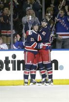 New York Rangers' Derek Stepan (21) and Rick Nash (61) celebrate a goal by Stepan during the first period of an NHL hockey game against the New Jersey Devils Saturday, Dec. 27, 2014, in New York. (AP Photo/Frank Franklin II)