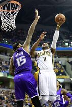 Indiana Pacers guard C.J. Miles (0) shoots against Sacramento Kings center DeMarcus Cousins in the second half of an NBA basketball game, Saturday, Jan. 31, 2015, in Indianapolis. Sacramento won 99-94. (AP Photo/R Brent Smith)