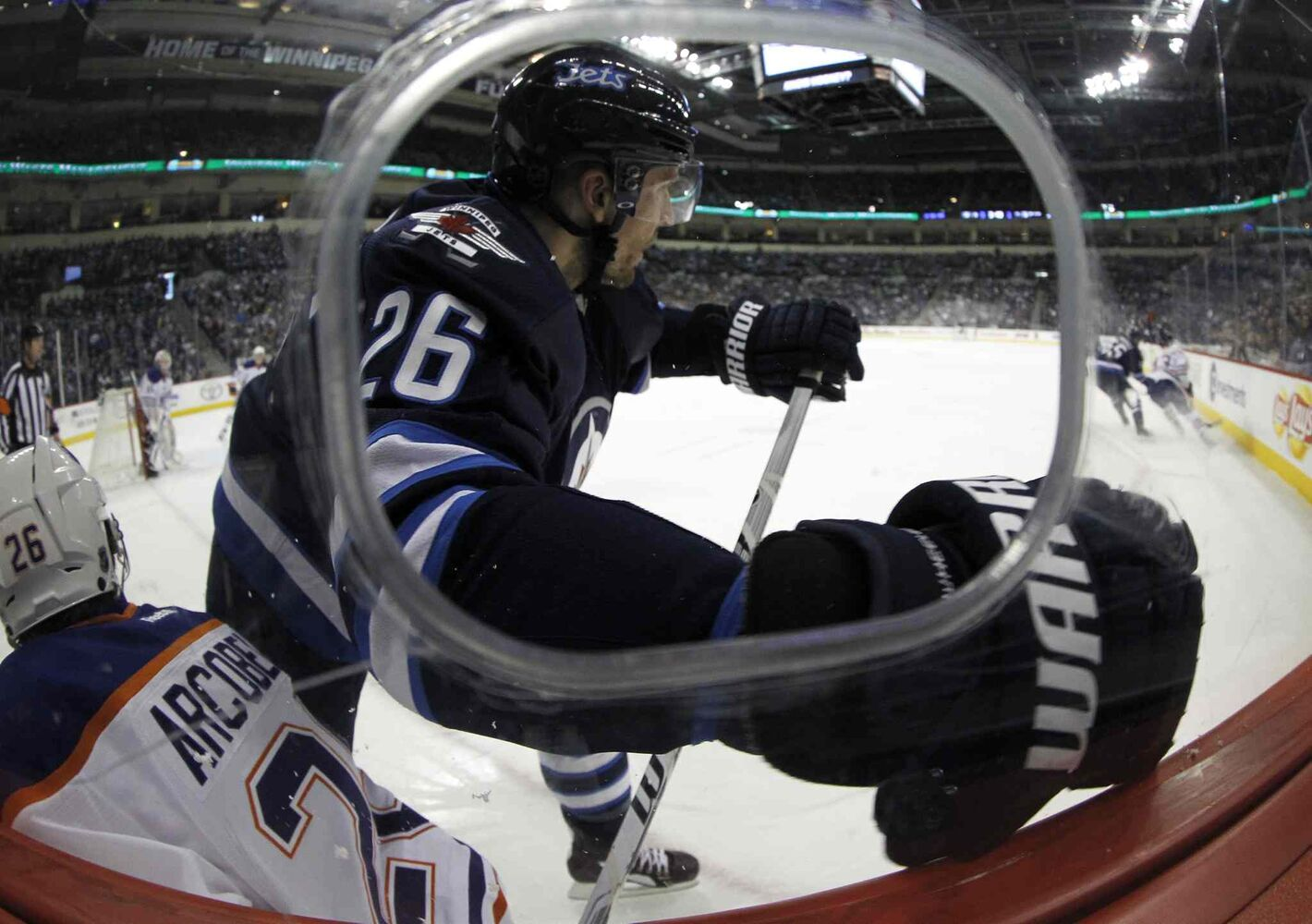 Winnipeg Jets' Blake Wheeler (26) hits Edmonton Oilers' Mark Arcobello (26) during the second period of Saturday's NHL game at MTS Centre. (Trevor Hagan / Winnipeg Free Press)