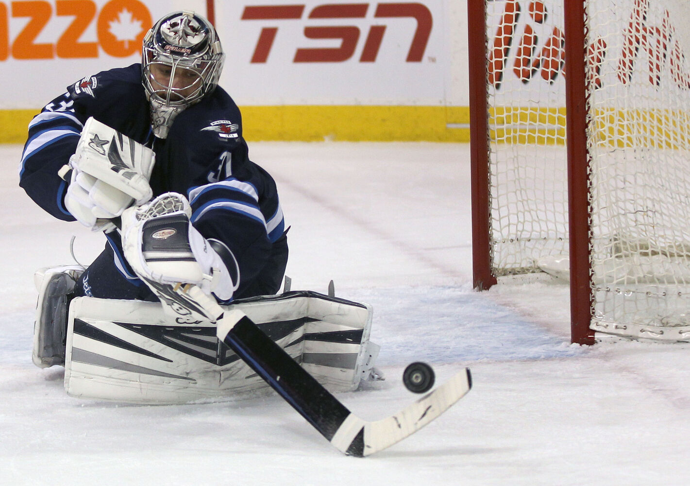 Winnipeg Jets' Ondrej Pavelec makes a save during Friday's game against the Vancouver Canucks in Winnipeg.