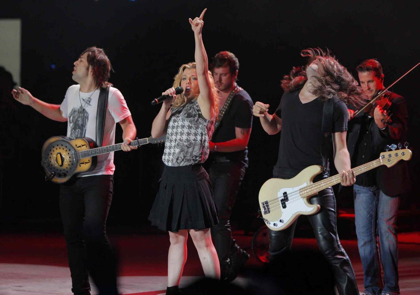 The Band Perry performs as Friday night's headliner, despite the rain.