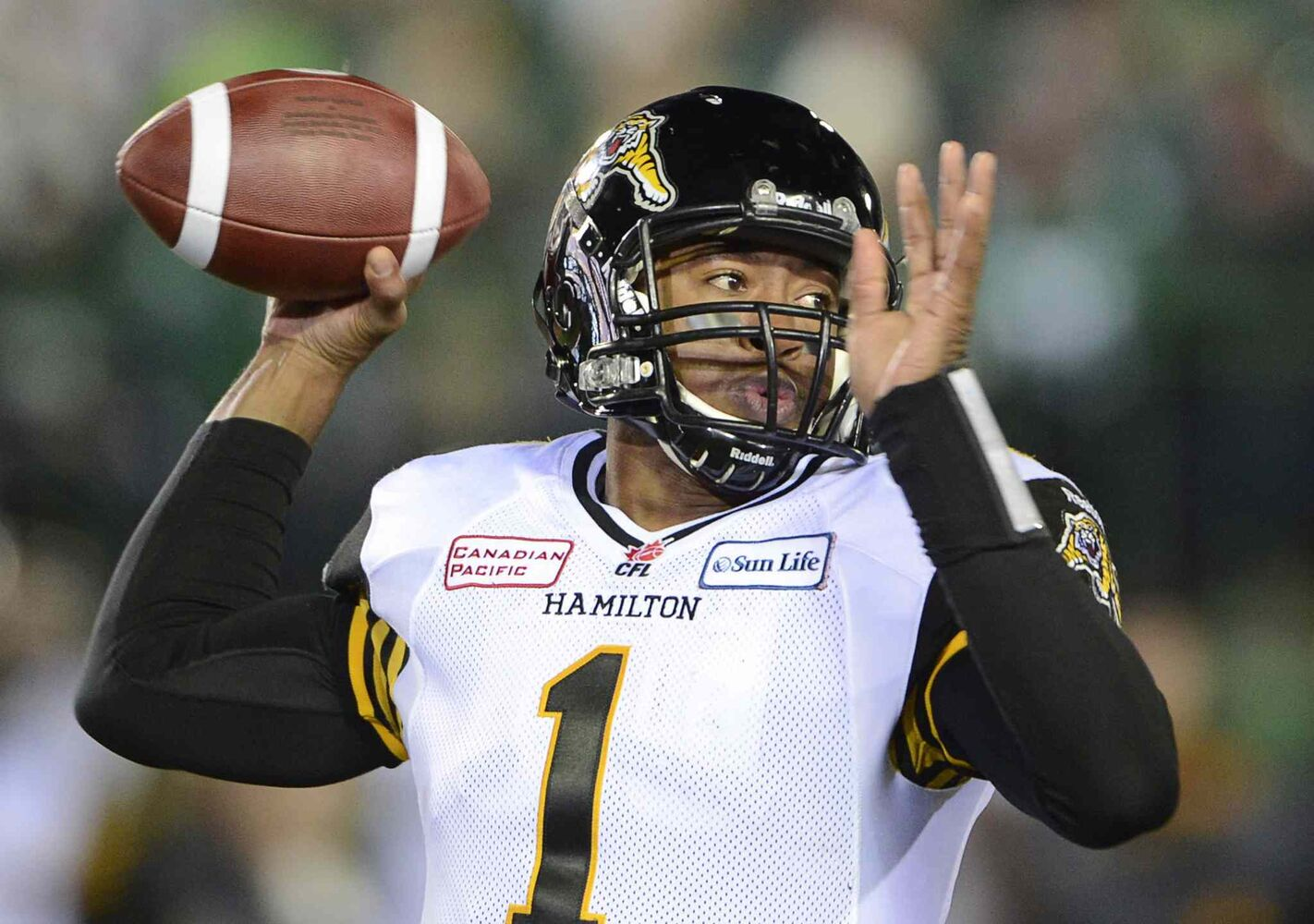 Hamilton Tiger-Cats quarterback Henry Burris fires a pass during the first quarter.