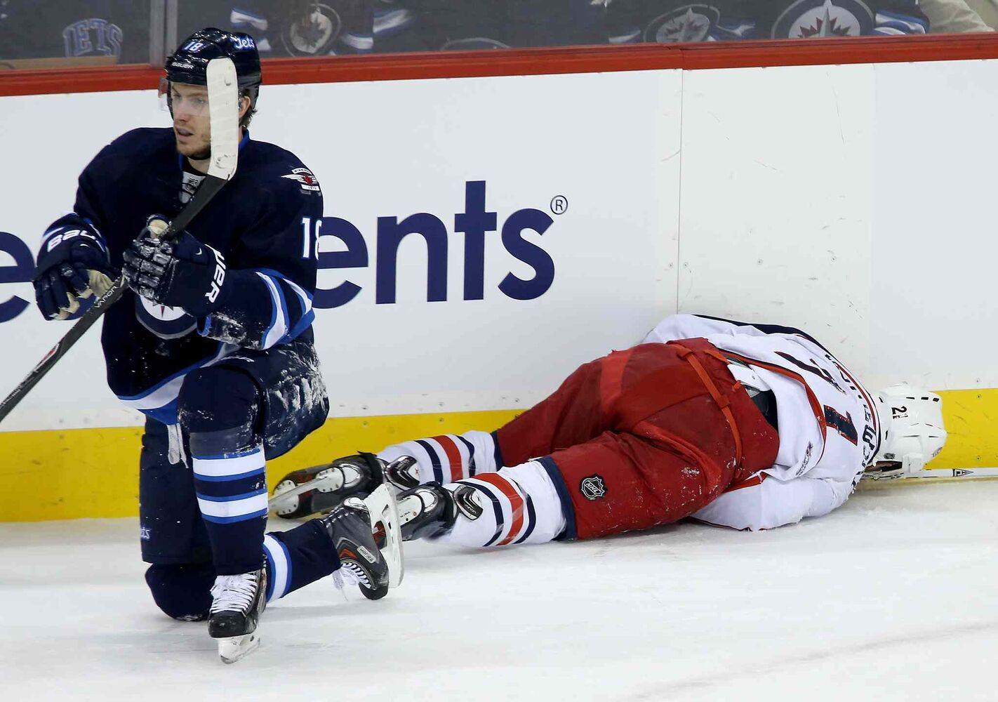 Winnipeg Jets' Bryan Little (18) and Columbus Blue Jackets' James Wisniewski (21) collided during the first period of Saturday's game. (Trevor Hagan / Winnipeg Free Press)