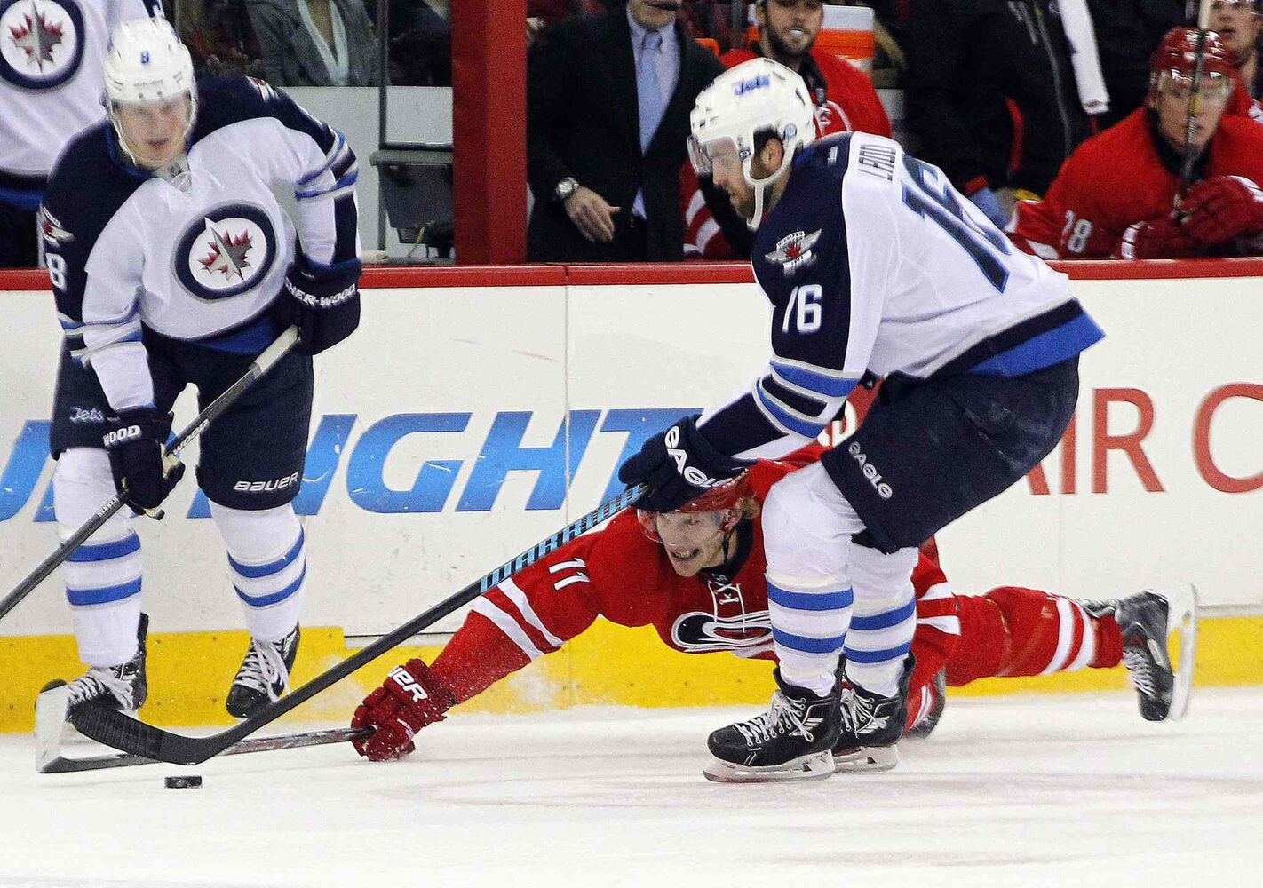 Carolina Hurricanes' Jordan Staal (11) dives for the puck against Winnipeg Jets' Jacob Trouba (8) and Andrew Ladd (16) during first period at the PNC Arena in Raleigh, N.C., on Tuesday. (Chris Seward / Raleigh News & Observer/ Tribune Media MCT)