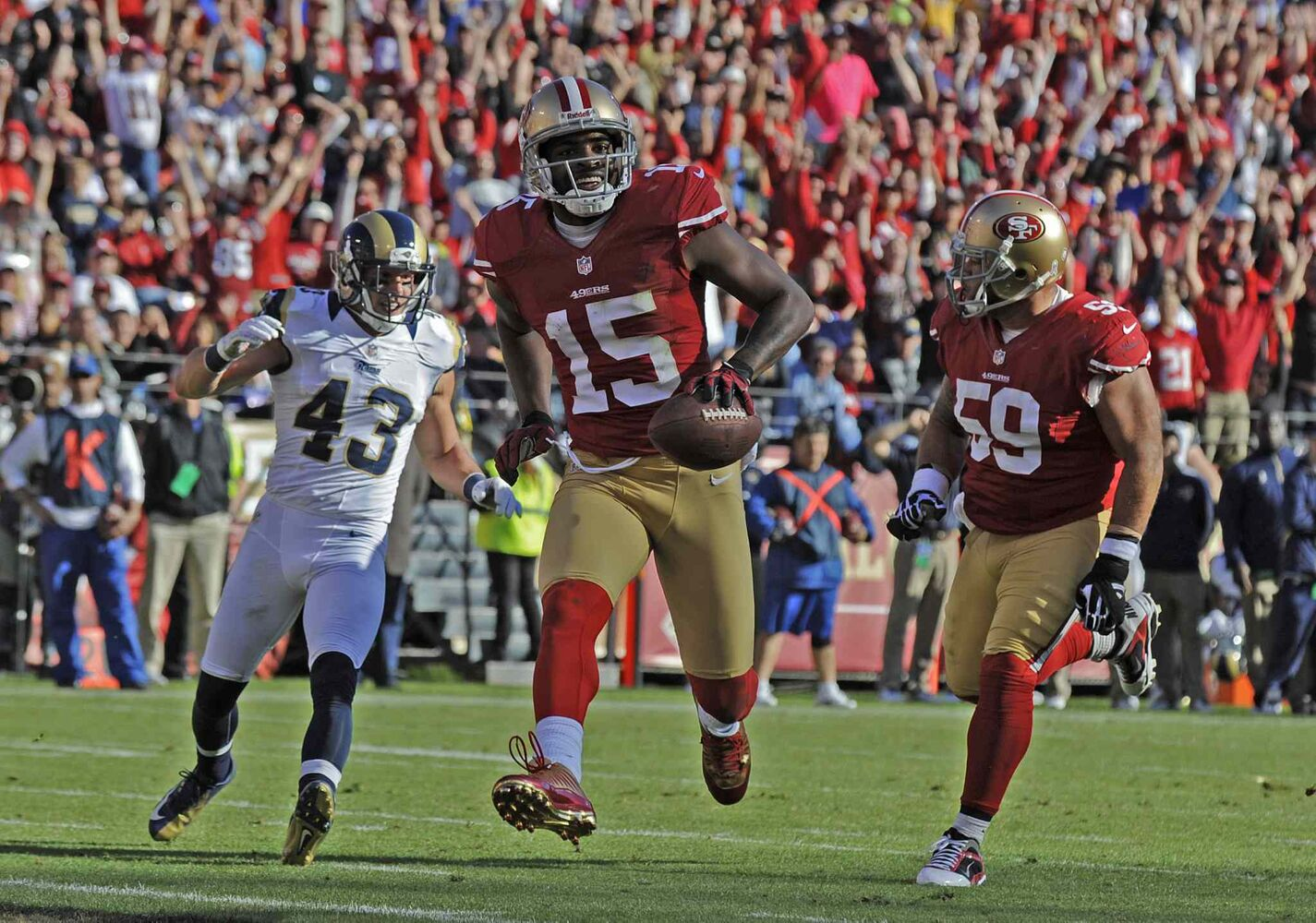 Michael Crabtree (15) of the San Francisco 49ers smiles as he runs in for a touchdown against the St. Louis Rams in the second quarter of their game at Candlestick Park in November 2012.