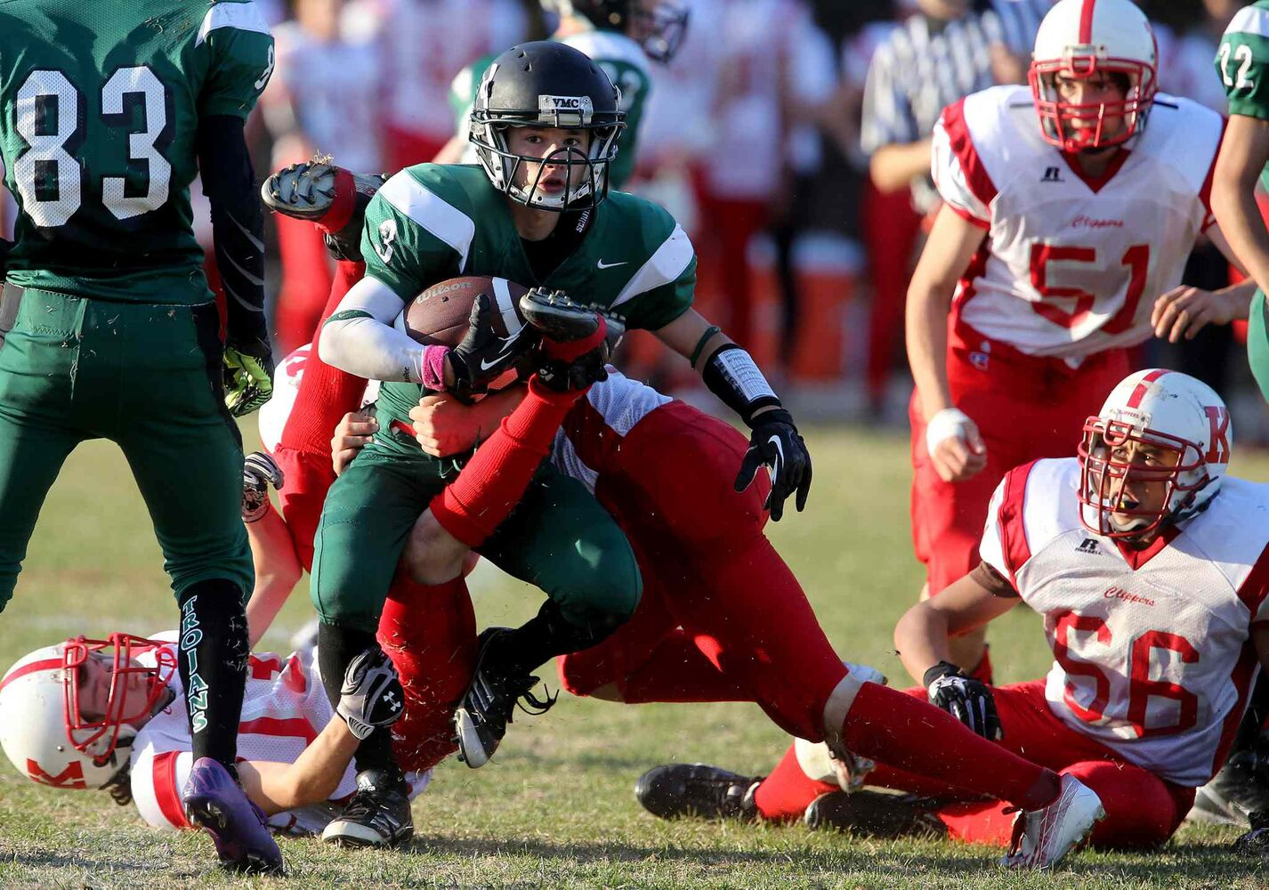Matt Lemay of the Vincent Massey Trojans is tackled by a gang of Kelvin Clippers.