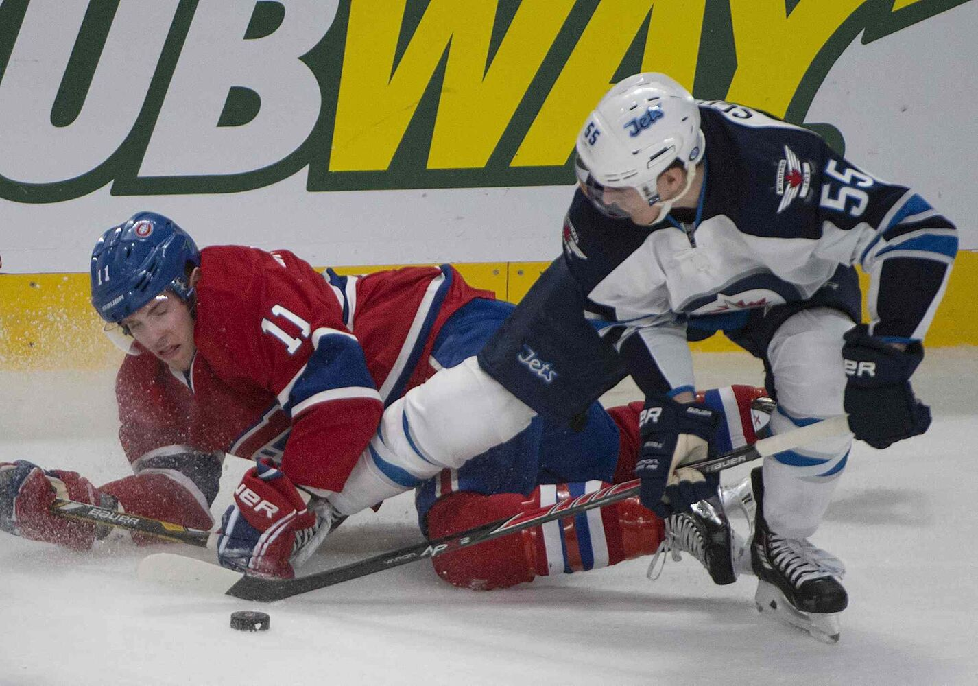 The Jets' Mark Scheifele wins a battle for the puck against Montreal's Brendan Gallagher during the glorious Jets 2-1 over the Habs Sunday.  (Peter McCabe / The Canadian Press)