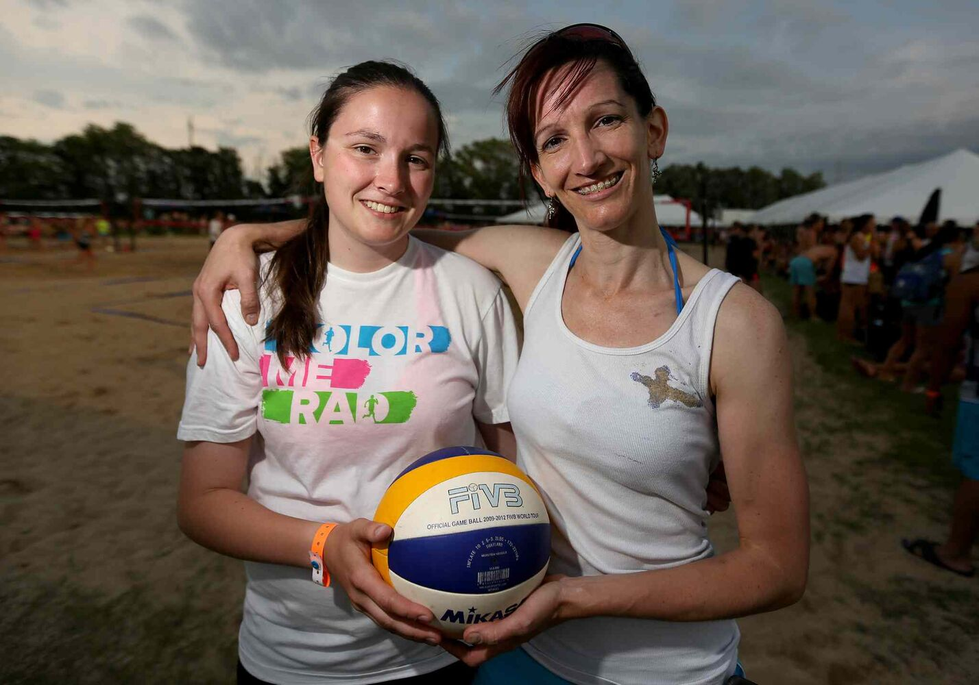 Mica Rosier, 18, and her mom, Rona, at the Super-Spike volleyball tournament at Maple Grove Rugby Park, Friday, July 18, 2014.  (TREVOR HAGAN/WINNIPEG FREE PRESS)