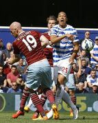 QPR's Bobby Zamora, right, vies for the ball with West Ham's James Collins during the English Premier League soccer match between QPR and West Ham United at Loftus Road stadium in London, Saturday, April 25, 2015. (AP Photo/Kirsty Wigglesworth)