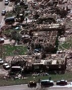 FILE - In this Tuesday, May 4, 1999, photo, a neighborhood in Moore, Okla., lays in ruins pm Tuesday, May 4, 1999, after a tornado flattened many houses and buildings in central Oklahoma, Monday, night. The powerful tornado in suburban Oklahoma City Monday, May 20, 2013, loosely followed the path of a killer twister that slammed the region in May 1999. (AP Photo/J. Pat Carter, File)
