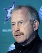 Dallas Stars General Manager Jim Nill responds to questions from reporters after a team morning workout on opening day of NHL hockey training camp, Friday, Sept. 19, 2014, in Fort Worth, Texas. (AP Photo/Tony Gutierrez)