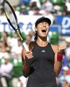 Ana Ivanovic of Serbia reacts after defeating Caroline Wozniacki of Denmark during their final match of the Pan Pacific Open Tennis tournament in Tokyo Sunday, Sept. 21, 2014. (AP Photo/Shizuo Kambayashi)
