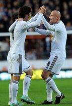 Swansea City's Ki Sung-Yueng left, celebrates with Jonjo Shelvey after scoring his side's first goal during the English Premier League soccer match between Hull City and Swansea City, at the KC Stadium, in Hull, England, Saturday, Dec. 20, 2014. (AP Photo/PA, Anna Gowthorpe) UNITED KINGDOM OUT NO SALES