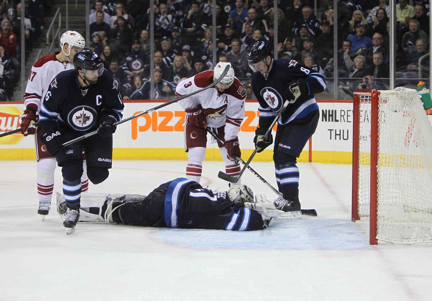Winnipeg Jets Ondrej Pavelec makes an overtime save against the Phoenix Coyotes in Winnipeg Thursday. (Ruth Bonneville / Winnipeg Free Press)