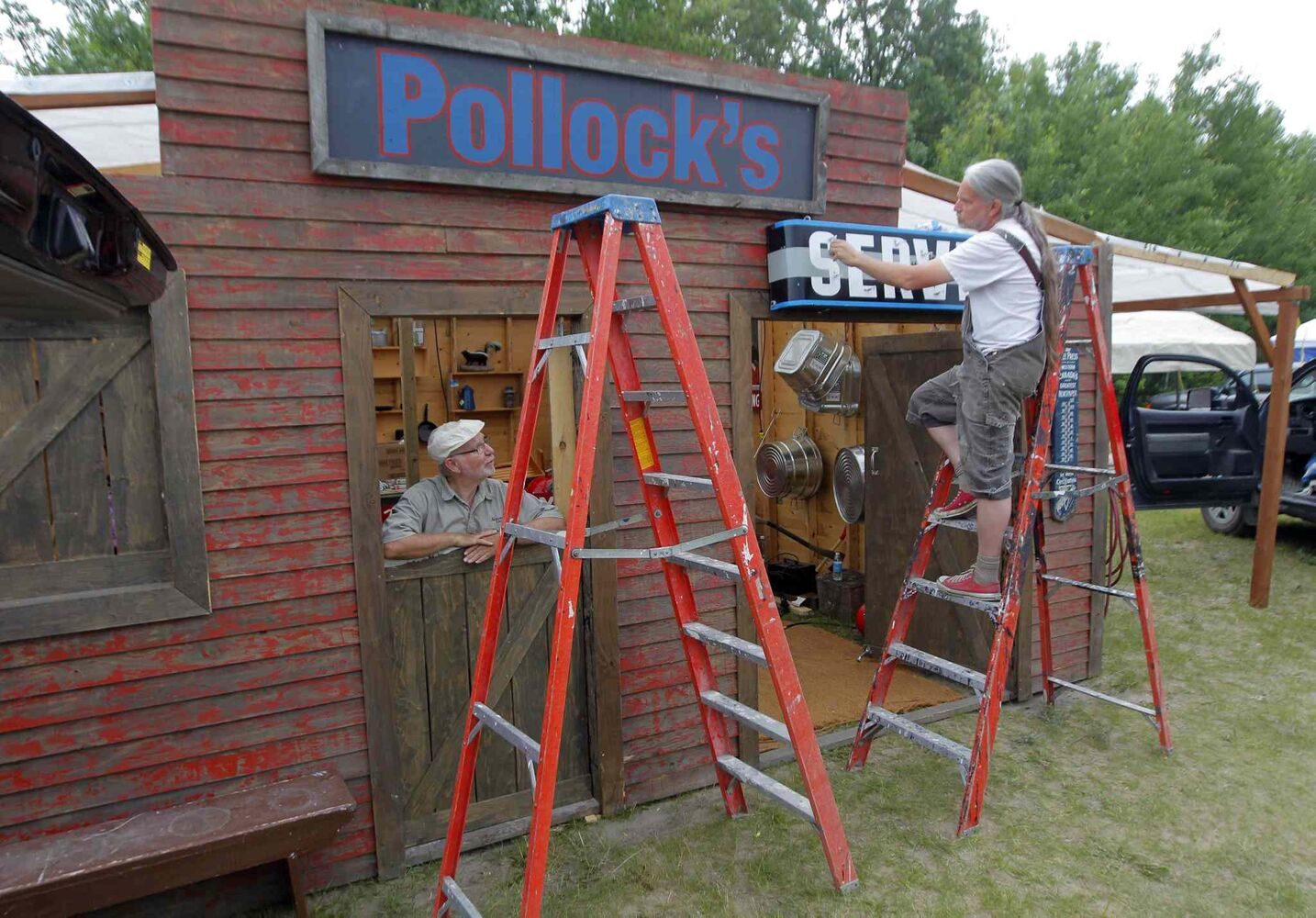 John and Mike Wolchock set up the Pollock Hardware fix-it-shop in the Birds Hill Park campground.    (BORIS MINKEVICH / WINNIPEG FREE PRESS)