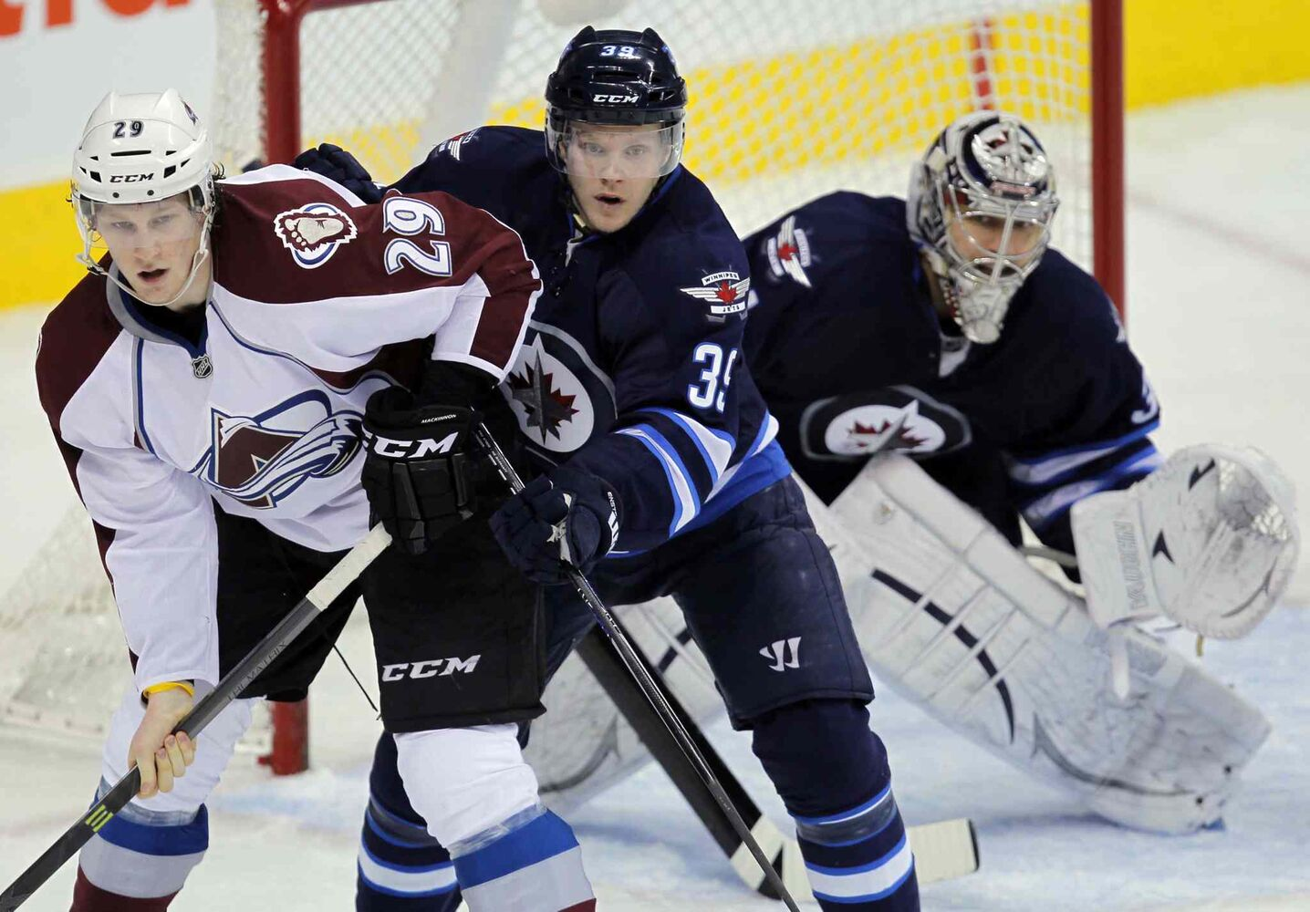 Nathan MacKinnon (left) of the Colorado Avalanche and Jets defenceman Tobias Enstrom jostle for positionin front of  Ondrej Pavelec in the second period. (BORIS MINKEVICH / WINNIPEG FREE PRESS)