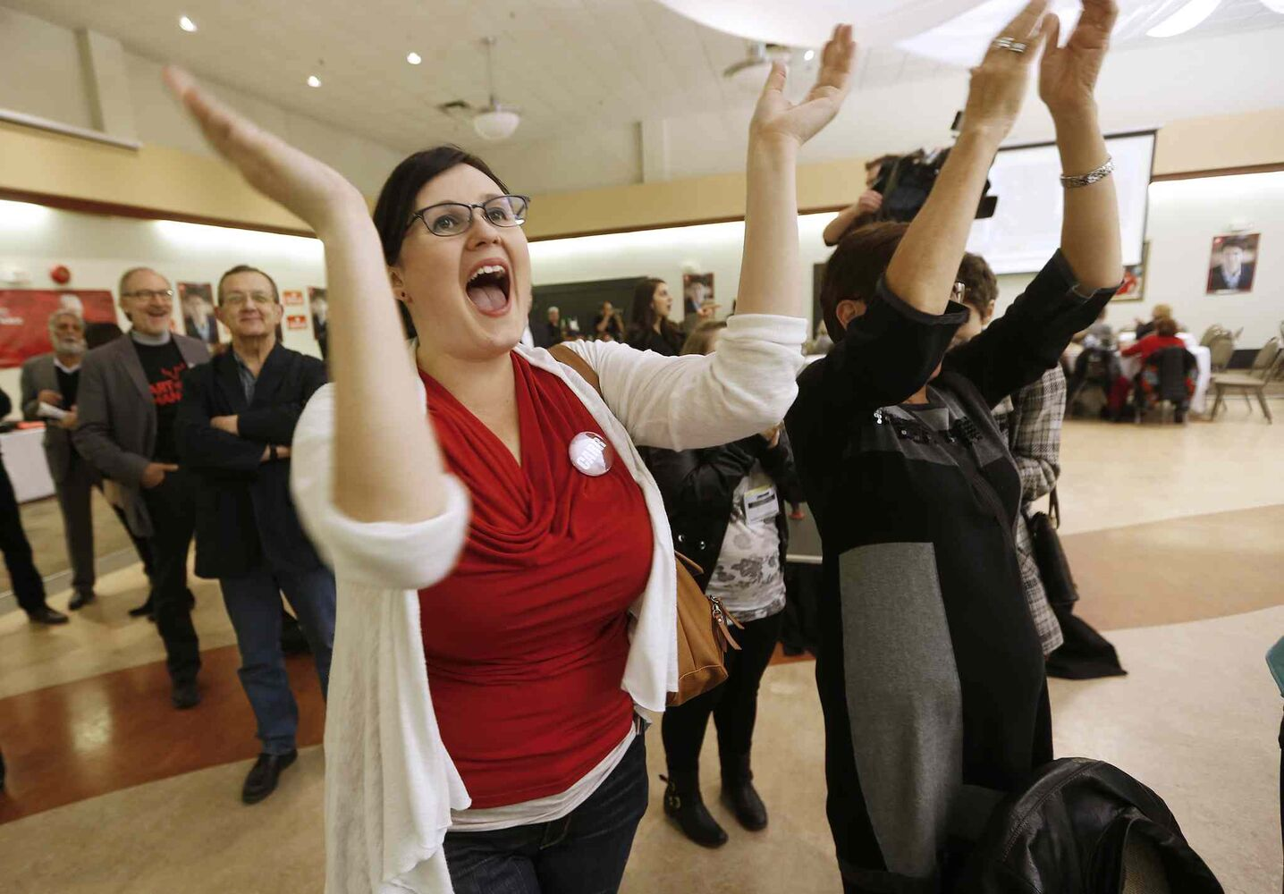 Randi Anderson celebrates the victory of Jim Carr, Liberal candidate in Winnipeg South Centre, over Conservative Party incumbent Joyce Bateman on election night in Winnipeg on Monday, October 19, 2015.  (John Woods / The Canadian Press)