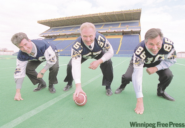 Ex-mayor Glen Murray, Lyle Bauer, Blue Bomber GM, and Premier Gary Doer worked out a funding restructing plan for the football club in 2000.