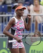Venus Williams celebrates after she defeated Samantha Stosur, of Australia, 6-4, 7-6 (3) at the Miami Open tennis tournament, Saturday, March 28, 2015 in Key Biscayne, Fla. (AP Photo/Wilfredo Lee)