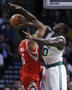 Boston Celtics forward Brandon Bass, right, covers Houston Rockets forward Terrence Jones (6) on a drive to the basket during the first quarter of an NBA basketball game in Boston, Friday Jan. 30, 2015. (AP Photo/Charles Krupa)