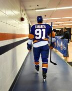 New York Islanders center John Tavares (91) returns to the locker room after warming up for Game 6 in the first round of the NHL hockey Stanley Cup playoffs against the Washington Capitals at Nassau Coliseum on Saturday, April 25, 2015, in Uniondale, N.Y. (AP Photo/Kathy Kmonicek)