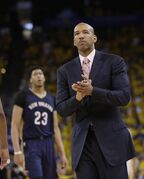 New Orleans Pelicans head coach Monty Williams walks onto the court during a timeout during the second half in Game 1 of the NBA basketball playoffs against the Golden State Warriors Saturday, April 18, 2015, in Oakland, Calif. Golden State won 106-99. (AP Photo/Marcio Jose Sanchez)