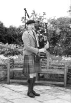 A bagpiper, an iconic symbol of Scotland, plays for the guests at the Glenmorangie House.