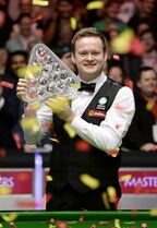 Shaun Murphy celebrates with the trophy after winning the 2015 Masters at Alexandra Palace, London, Sunday Jan. 18, 2015. Shaun Murphy became the 10th man to win snooker's Triple Crown as he stunned Neil Robertson 10-2 to take the title. (AP Photo/PA, Andrew Matthews) UNITED KINGDOM OUT NO SALES NO ARCHIVE