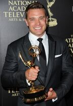 """FILE - In this June 22, 2014 file photo, actor Billy Miller poses in the press room with the award for outstanding lead actor in a drama series for """"The Young and the Restless"""" at the 41st annual Daytime Emmy Awards in Beverly Hills, Calif. Miller is now playing Jason Morgan on ABC's"""