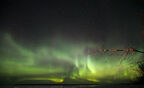 The lights of the aurora borealis over Lake Winnipeg at Victoria Beach late at night on March 18th. A geomagnetic storm sent solar rays soaring into the Earth's atmosphere, leading to significant northern lights activity that was visible across much of North America March 18 and 19th. (Melissa Tait / Winnipeg Free Press)