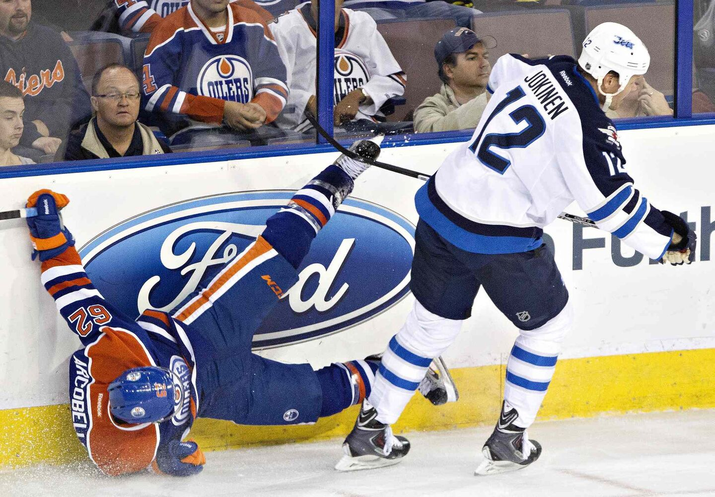 Olli Jokinen (12) checks Edmonton Oilers Mark Arcobello (62) during the second period.
