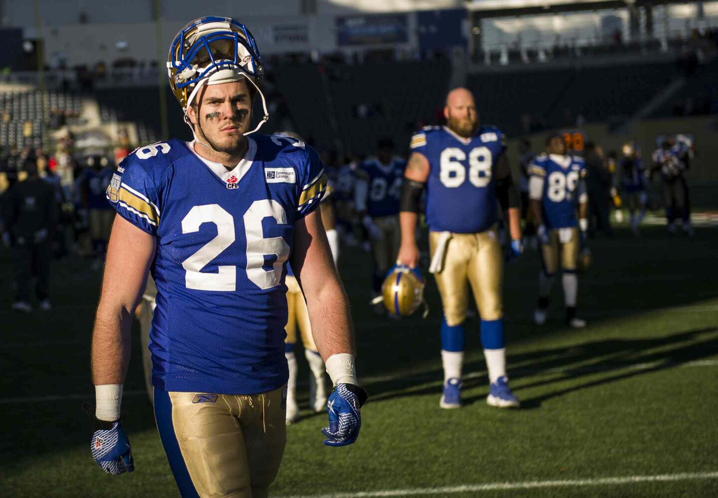 Winnipeg Blue Bombers Carl Fitzgerald (#26) looks dejected as he leaves the field.