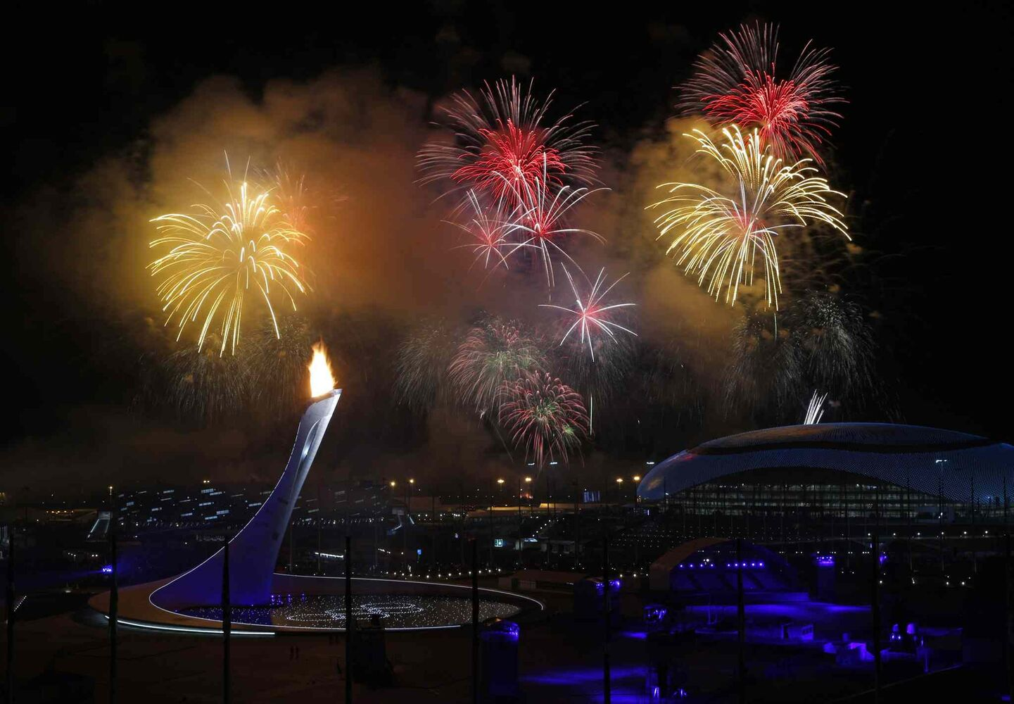 Fireworks are seen over the Olympic Cauldron during the opening ceremony of the 2014 Winter Olympics in Sochi, Russia, Friday, Feb. 7, 2014. (AP Photo/Julio Cortez)