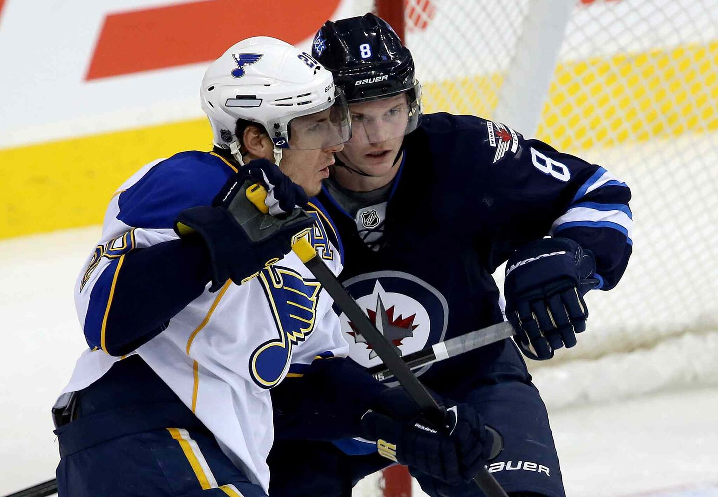 St. Louis Blues forward Alexander Steen (20) and Winnipeg Jets defenceman Jacob Trouba battle in front of the Jets net during the first period. (TREVOR HAGAN / THE CANADIAN PRESS)