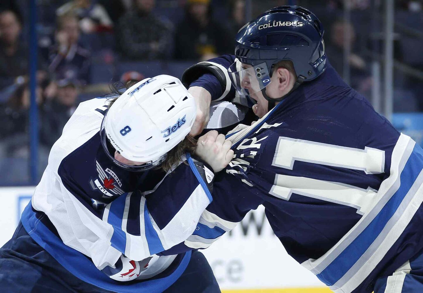 Blue Jackets left wing Matt Calvert (right) and Jets defenseman Jacob Trouba exchange blows during the first period Monday night. (Sam Green / Tribune Media MCT)