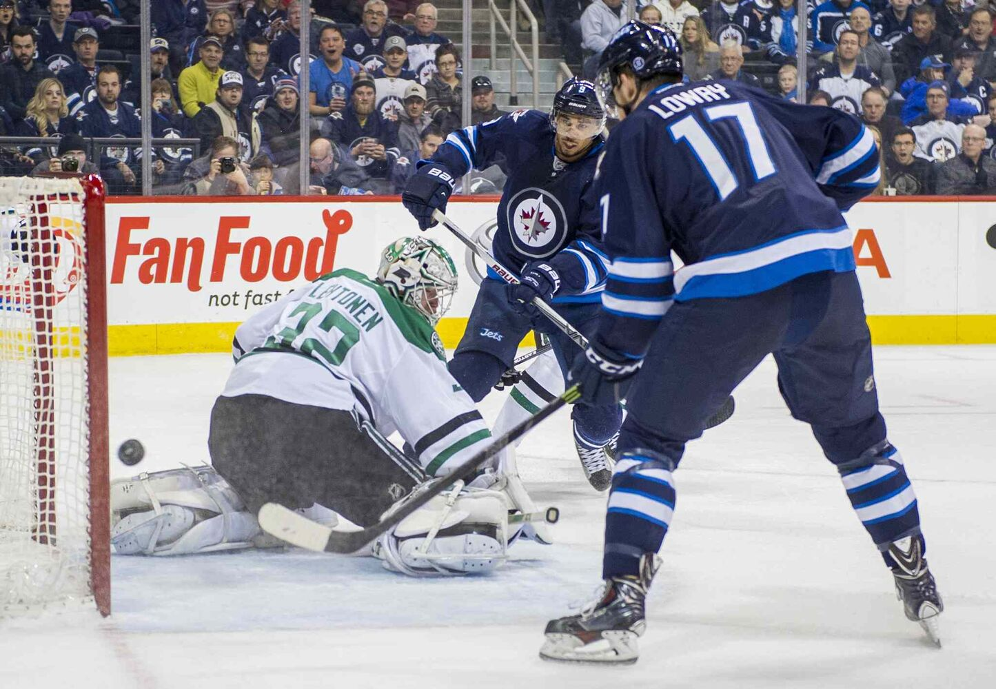 Dallas Stars goaltender Kari Lehtonen (#32) stops the shot as Winnipeg Jets Evander Kane (#9) and Adam Lowry (#17) look on during second period. (David Lipnowski / Winnipeg Free Press)