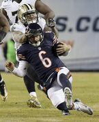 Chicago Bears quarterback Jay Cutler (6) slides after carrying the ball against New Orleans Saints strong safety Kenny Vaccaro (32) during the second half of an NFL football game Monday, Dec. 15, 2014, in Chicago. (AP Photo/Nam Y. Huh)