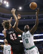 Boston Celtics' Jeff Green (8) and Portland Trail Blazers' Robin Lopez (42) battle for a rebound in the first quarter of an NBA basketball game in Boston, Sunday, Nov. 23, 2014. (AP Photo/Michael Dwyer)
