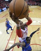 Houston Rockets' Dwight Howard (12) scores over Dallas Mavericks' Amar'e Stoudemire (1) during the first half in Game 1 in the first round of the NBA basketball playoffs Saturday, April 18, 2015, in Houston. (AP Photo/David J. Phillip)