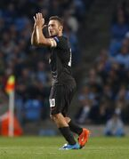 Francesco Totti captain and scorer of Roma applauds his fans during a Champions League group E soccer match between Manchester City and Roma at the Etihad Stadium, Manchester, England, Tuesday, Sept. 30, 2014. The match ended 1-1. (AP Photo/Jon Super)