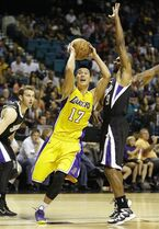 Los Angeles Lakers guard Jeremy Lin (17) drives to the basket pas Sacramento Kings guard Ramon Sessions (9) during a preseason NBA basketball game Friday, Oct. 24, 2014, in Las Vegas. (AP Photo/John Locher)
