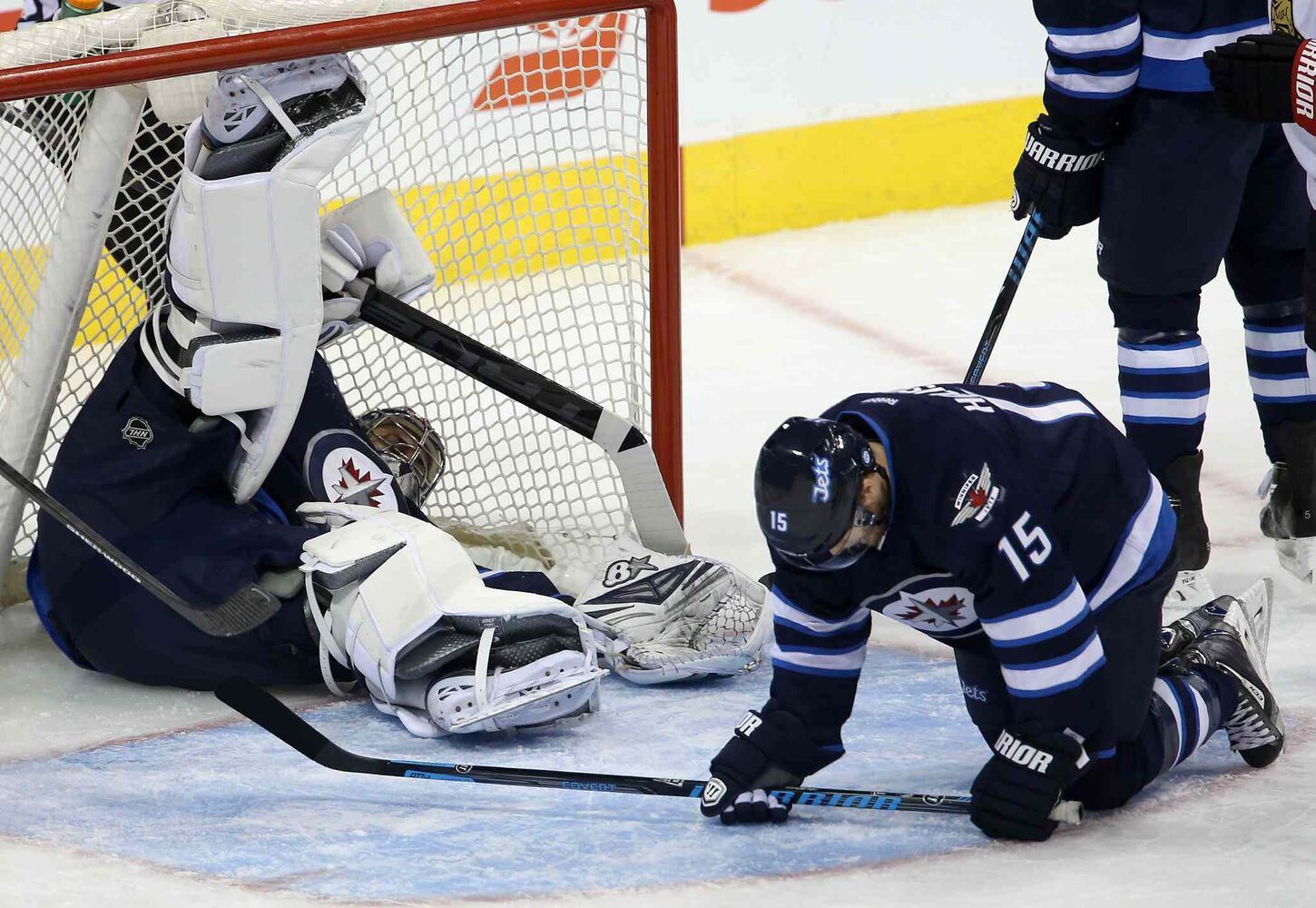 Winnipeg Jets' goaltender Ondrej Pavelec (31) lies in the net after a puck took a strange bounce off of Matt Halischuk (15). The goal was credited to Ottawa Senators' Milan Michalek (9), not shown, during first period NHL hockey action at MTS Centre in Winnipeg Saturday. (TREVOR HAGAN / WINNIPEG FREE PRESS)