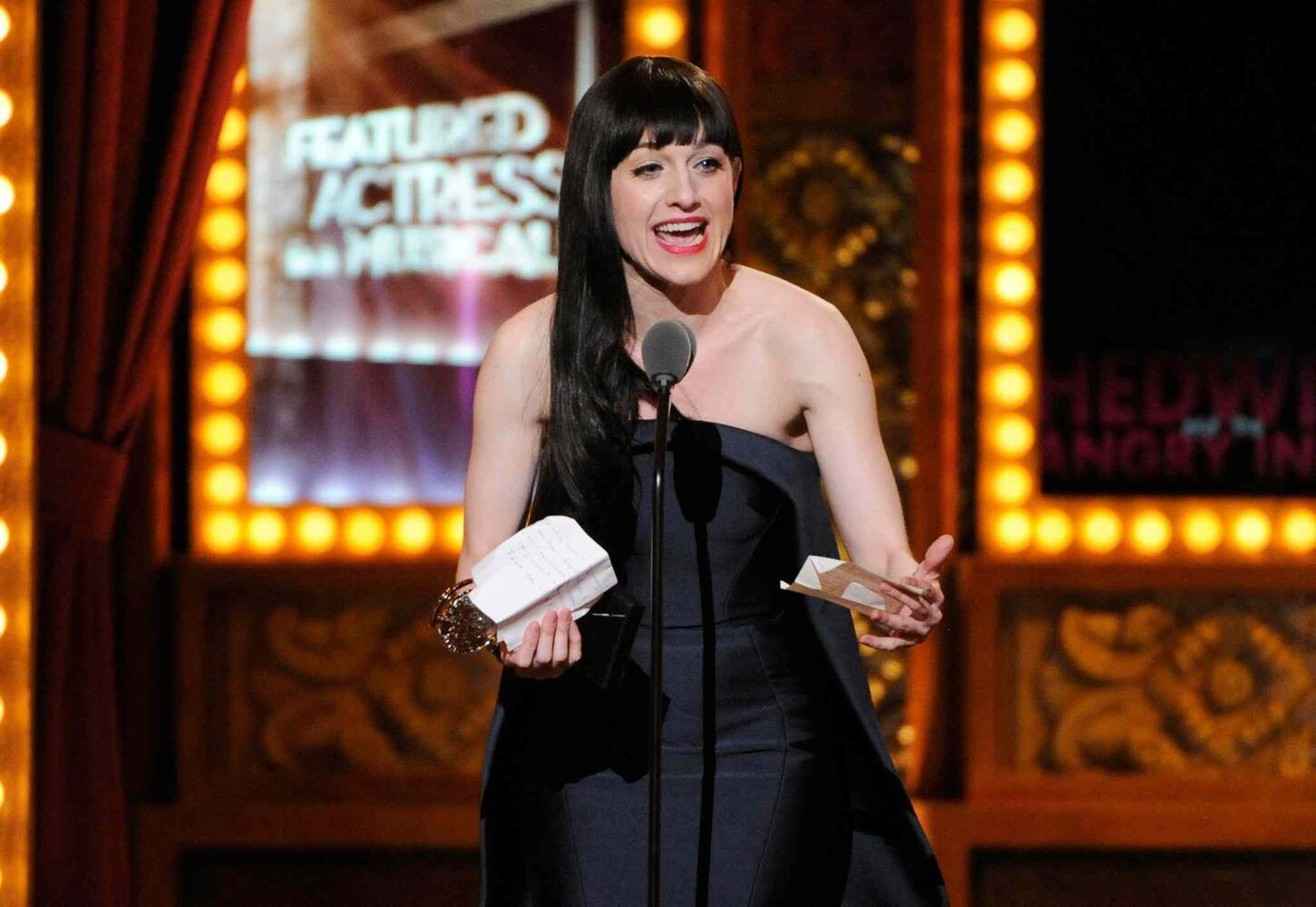 "Lena Hall accepts the award for best performance by an actress in a featured role in a musical for ""Hedwig and the Angry Inch"". (Evan Agostini / The Associated Press)"