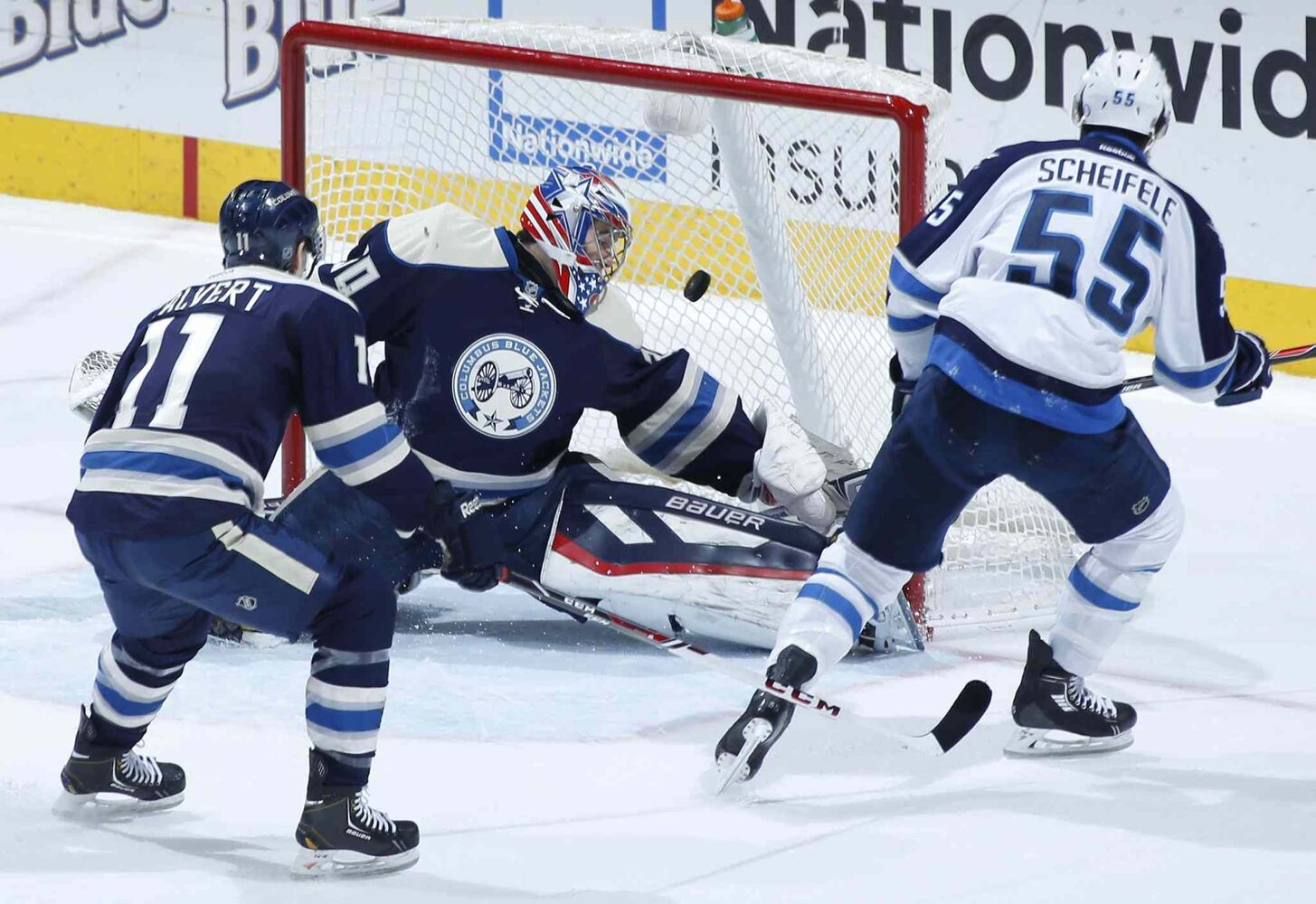 Jets rookie centre Mark Scheifele opens the scoring against Blue Jackets goalie Mike McKenna, Monday night.
