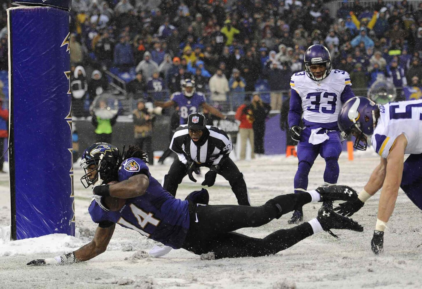 Baltimore Ravens wide receiver Marlon Brown (14) scores a touchdown in the second half against the Minnesota Vikings. (Nick Wass / The Associated Press)